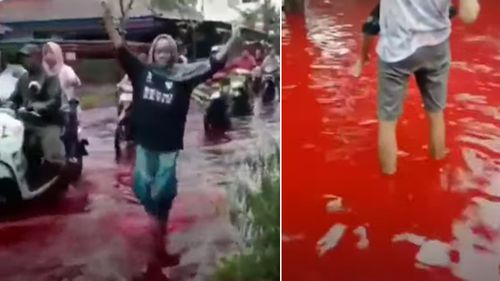 An Indonesian village has been inundated by blood-red water after flooding hit a local batik factory.