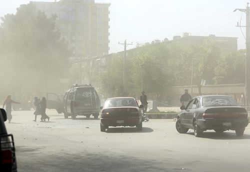 Dust fills the air after the explosion. Picture: AAP