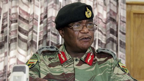Zimbabwe's Army Commander, Constantino Chiwenga addresses a press conference in Harare. (AAP)