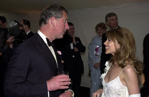 Over the course of her career, Kylie Minogue has met a number of celebrities, including the Prince of Wales at a charity gala dinner in 2001. Picture: PA