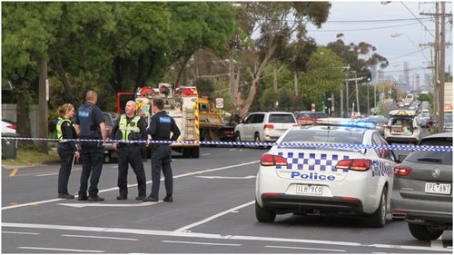 A man is in custody after allegedly crashing a stolen tow truck in Melbourne's Sunshine this evening.