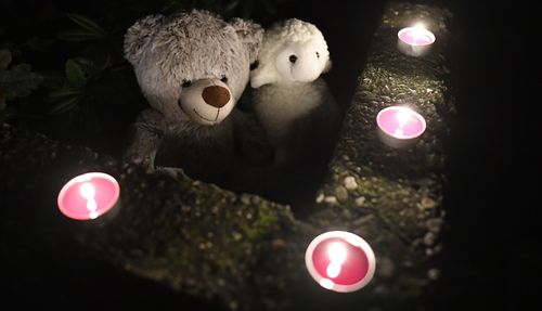 Teddy bears and candles are displayed in front of a house, Thursday, Sept. 3, 2020, in Solingen, Germany.