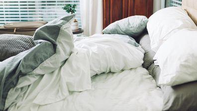Comfortable bed has been slept in.