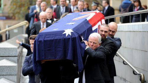 """Richards' casket was carried out to the strains of Frank Sinatra's """"New York, New York. (AAP)"""