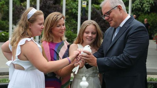 Prime Minister Scott Morrison pictured with his wife Jenny and two daughters.
