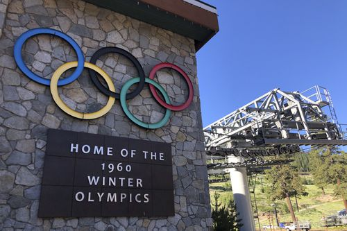 A sign marking the 1960 Winter Olympics is seen by a chairlift at Squaw Valley Ski Resort in Olympic Valley.