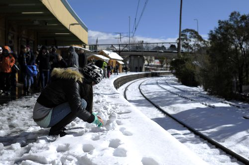 Snow has covered parts of New South Wales overnight, causing major road closures as wild weather continues across the state.