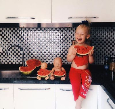 Stefani - chilling in the kitchen with her besties.