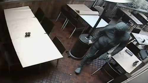 CCTV showed a masked man in the restaurant, who police allege was the restaurateur himself.