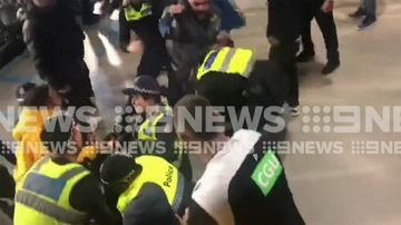 Fan clash with cops at AFL preliminary blockbuster