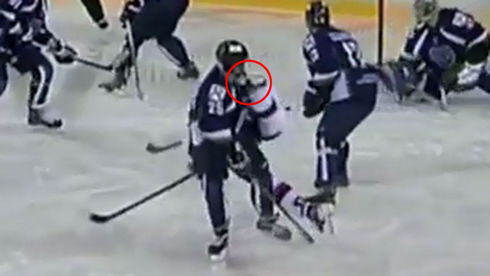 Russian ice hockey player Vital Sitnikov cops a rival's skate to the throat. (Supplied)