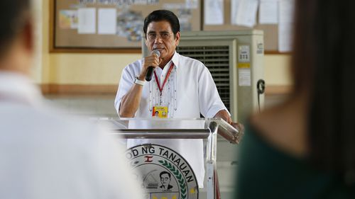 Tanauan City Mayor Antonio Halili, who became known for parading drug suspects in public but also alleged to have drug ties himself, was shot to death during a flag-raising ceremony in front of horrified employees. (AAP)