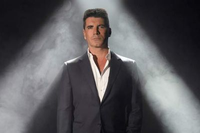 """It's Simon Cowell's job to sit on different panels and <strike>discover raw talent</strike> say mean things, and one of his mean barbs saved a life. When Jacqui Gray auditioned for UK's <i>The X Factor</i>, Simon said, """"Something happens to your throat when you sing. It is quite raspy. It sounds as if you have someone else in there, like you were choking on something."""" Sharon Osbourne, another judge, suggested she check it out. Turns out, it was a potentially fatal lung disease."""