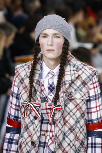 The master of tailoring sent male models down the Paris Runway with plaited pigtails and enough makeup to make Marie Antoinette cough into her cake.