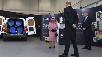 Britain's Queen Elizabeth II, Prince William and Chief Executive Gary Aitkenhead, right, view a demonstration of a Forensic Explosives Investigation, with a model explosive device in a vehicle, during a visit visit the Defence Science and Technology Laboratory (DSTL) at Porton Down, England, Thursday Oct. 15, 2020, to view the Energetics Enclosure and display of weaponry and tactics used in counter intelligence