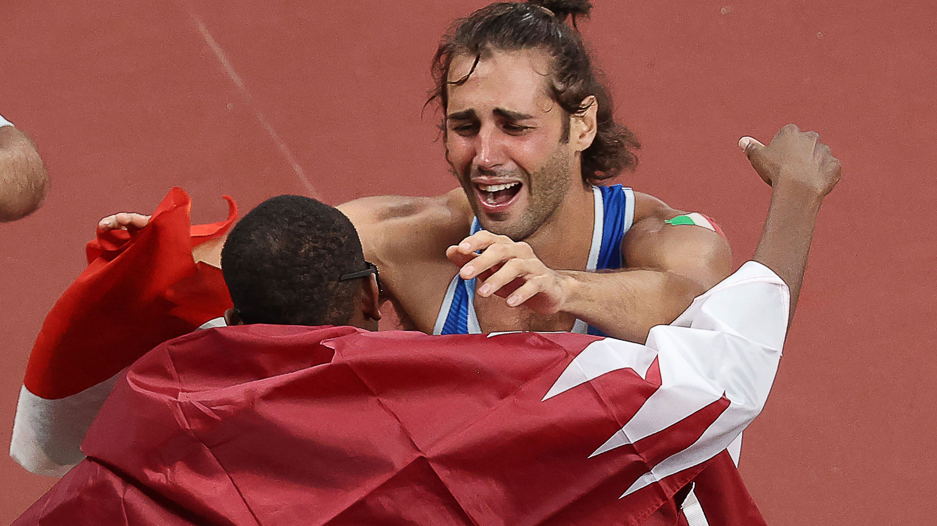 Mutaz Essa Barshim of Qatar and Italy's Gianmarco Tamberi embrace after deciding to share gold.