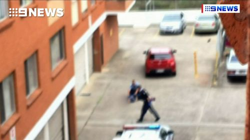 An 18-year-old man was arrested near where the woman, 64, was found allegedly beaten to death in her Sydney unit