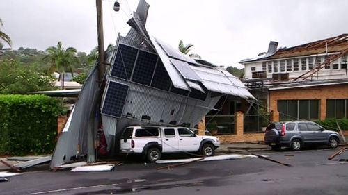 Cars are stuck beneath the roof until it can be safely removed. (9NEWS)