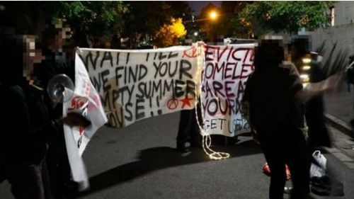 Protesters outside Robert Doyle's home in February. (insurrectionnewsworldwide.com)