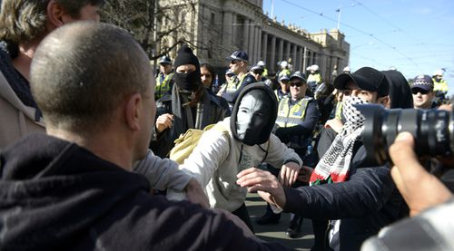 IN PICTURES: Anti-Islam and anti-racism protesters clash at Melbourne rally (Gallery)