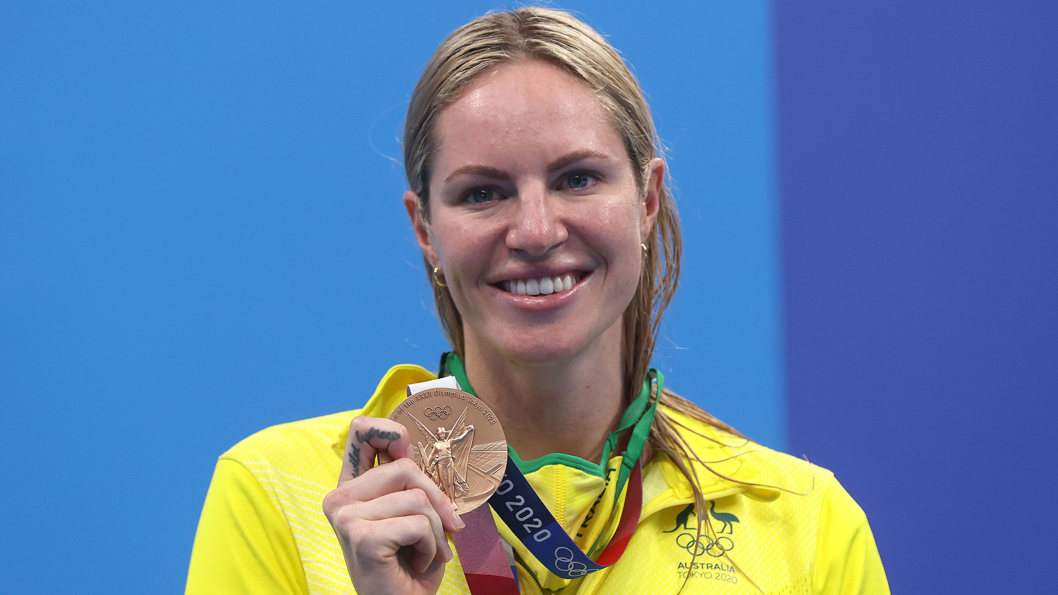 Emily Seebohm beams as she shows off her bronze medal.