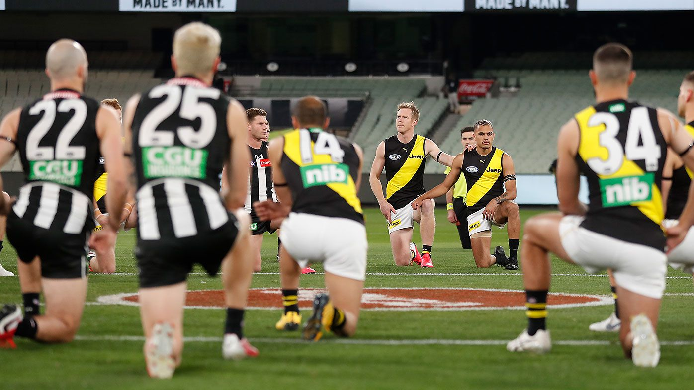 Collingwood and Richmond players take part in powerful Black Lives Matter gesture