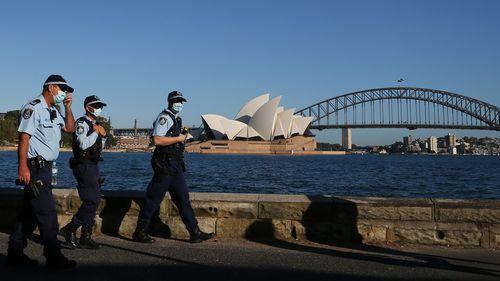 NSW Police patrol the Sydney Harbour shorefront.