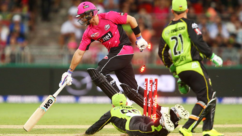 Michael Lumb of the Sydney Sixers slides in to avoid a runout against Sydney Thunder. (Getty)