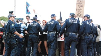 The Public Order and Riot Squad forcing marchers off the road (Nicholas McCallum)