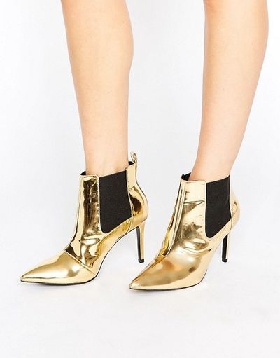 "<a href=""http://www.asos.com/au/office/office-angles-gold-mirror-heeled-ankle-boots/prd/7031976?cid=4172&clr=Goldmirrorpu&iid=7031976"" target=""_blank"">Asos</a> gold mirror ankle boots, $133<br>"