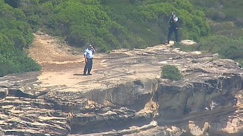 Detectives look at the conditions below. (9NEWS)