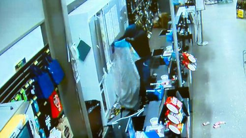 A group of men were caught on CCTV camera forcing their way into at least seven businesses and ransacking each location. Picture: Supplied.