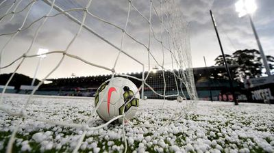 Hail stones cover the pitch following a storm before start of play in the round 27 A-League match between the Western Sydney Wanderers and the Perth Glory at Parramatta Stadium. Photo: AAP