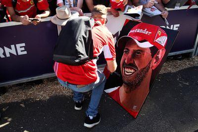 Sebastian Vettel signs a portrait of himself produced by a fan outside the Grand Prix. (AAP)
