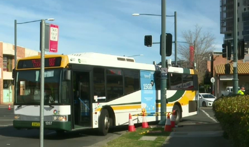 A woman is critical after being hit by a bus.