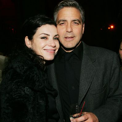Actor George Clooney and his former co-star Julianna Margulies attend the Syriana premiere after party at The New York Public Library November 20, 2005 in New York City.
