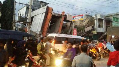 Buildings toppled in devastating Indonesia earthquake (Gallery)