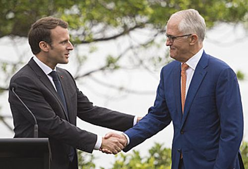 """Emmanuel Macron and Malcolm Turnbull: Lucy """"charmed"""" by comment (AAP)"""