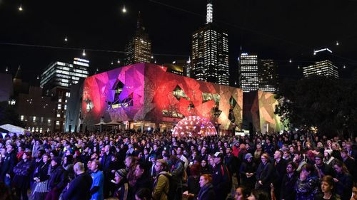 More than a thousand people attended the vigil at Federation Square in Melbourne's CBD. (AAP)