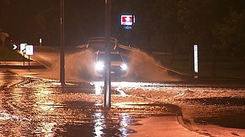 The rain saw floodwaters rise rapidly on streets in the area, leaving drivers forced to navigate inundated roads (Supplied).