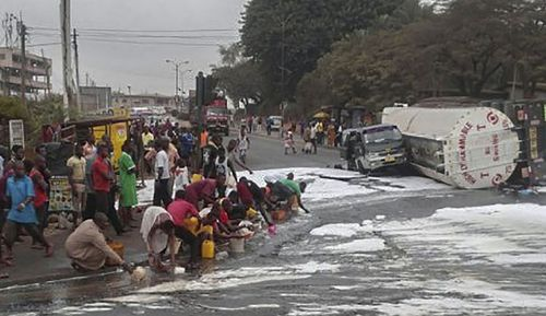 Nigerians collecting fuel from a crashed Petroleum tanker moments before it exploded on the Ikom-Calabar Highway, Calabar, Nigeria.