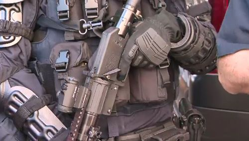olice denied they were showing off the weapons today after copping criticism over the handling of the Collingwood riot.