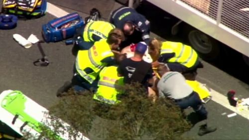 Man hit by truck 'while changing his tyre' on the Cunningham Highway in Yamanto, southeast Queensland
