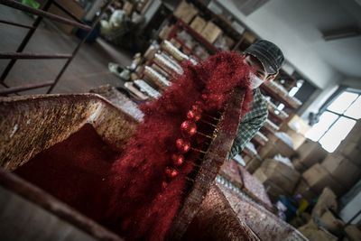 <p>Wei and his father spend 10 hours in this factory every day producing plastic snowflakes for about 3,000 RMB ($593) per month. </p><p></p>
