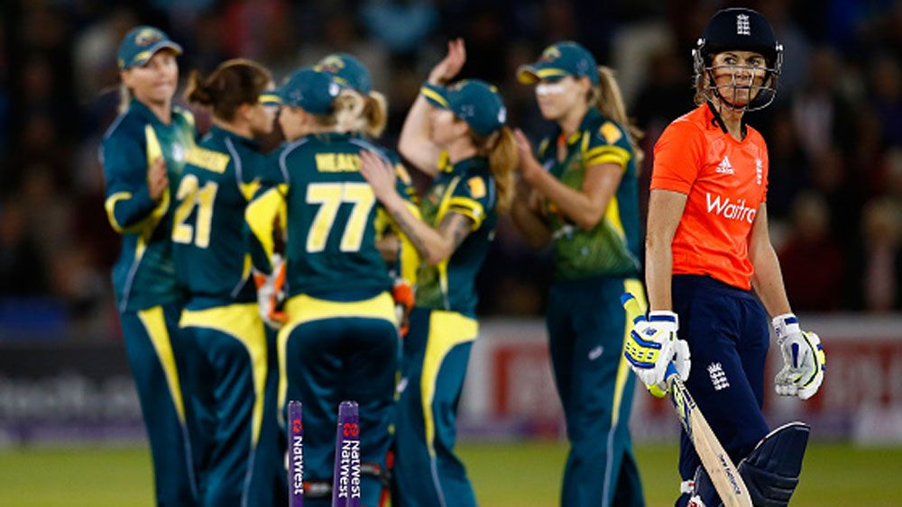 Australian players celebrate the wicket England captain Charlotte Edwards. (Getty)