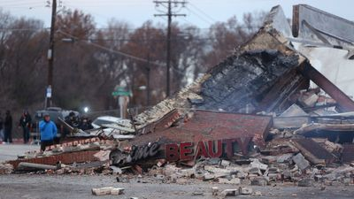 The smoldering remains of a beauty salon burnt to the ground during the Ferguson riots. (AAP)