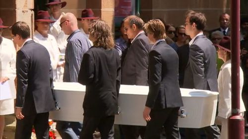 Tori Johnson's father Ken and partner Thomas Zinn are among the people carrying Mr Johnson's coffin into the church. (9NEWS)
