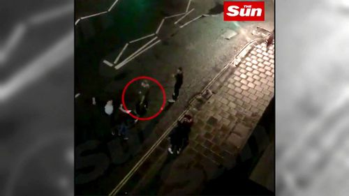 Stokes is seen knocking one man to the ground before slapping another man in the face. (The Sun)