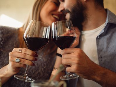 Woman and man drinking wine together