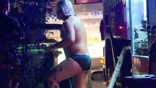 Wearing only his undies, Mr Wakemaker brandished a garden hose to tackle the blaze. (9NEWS)